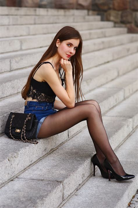 Lacy black top, denim shorts with a high waist and black